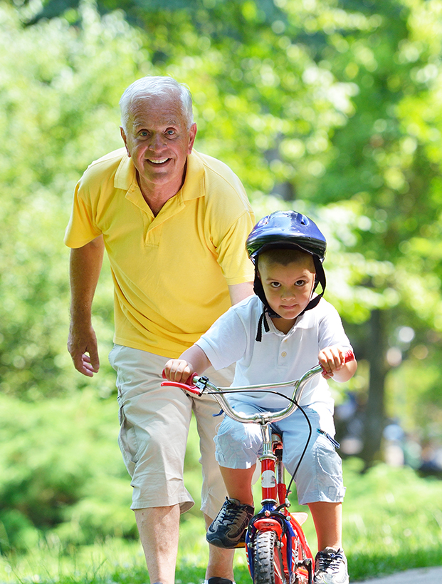 grandpa with grandson on bike