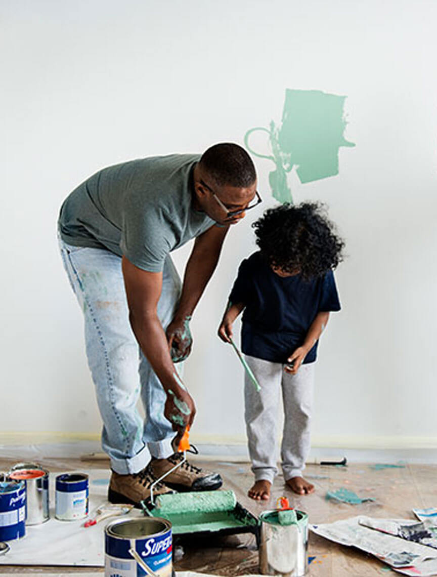 family painting a wall