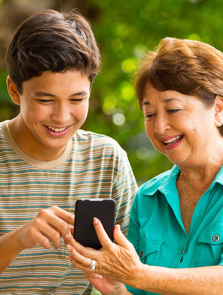 Grandma and Grandson on mobile device