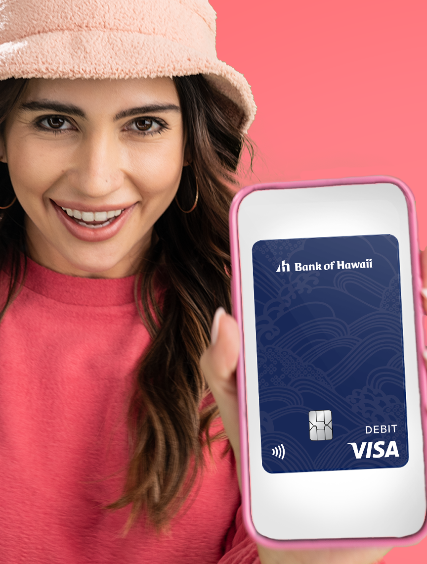 Woman holding phone with debit card on screen