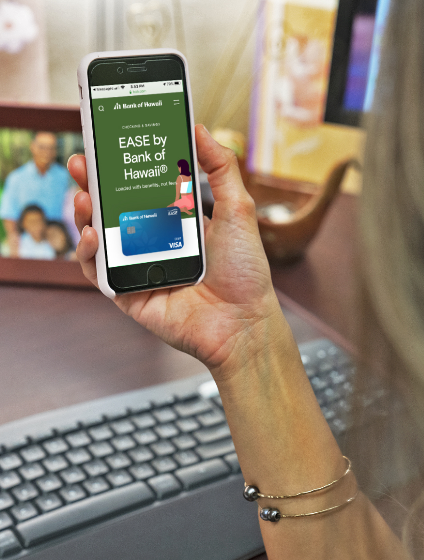 Woman looking at her phone and sees EASE checking account